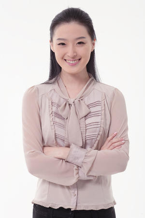 nobleness: Asian business woman smiling with arms folded - isolated on white