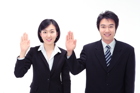 Asian business people taking oath - isolated on white Stock Photo