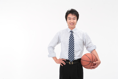 Asian businessman with a basketball - isolated on white Stock Photo