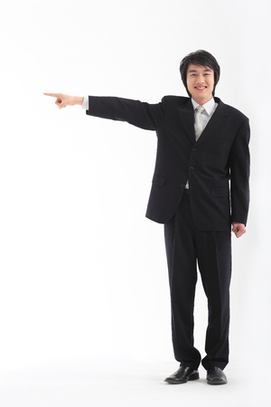 Asian businessman posing in the studio - isolated on white
