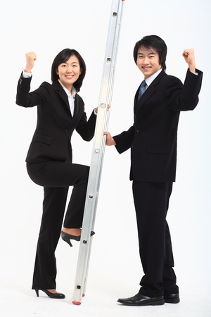 Young Asian business people posing in the studio - isolated on white