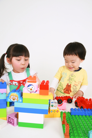 Asians kids playing with toys - isolated on white Stock Photo