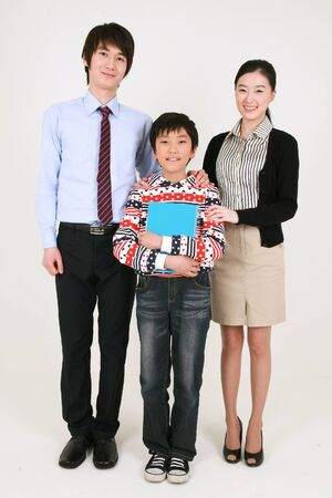 A boy standing with two teachers