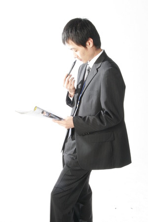 Young Asian businessman posing in the studio - isolated on white