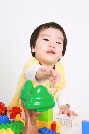 plaything: Asians kids posing in the sudio - isolated on white