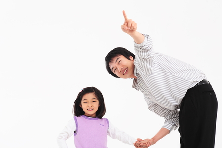 An asian girl and a man smiling - isolated on white