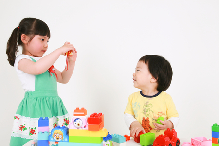 parish: Asians kids playing with toys - isolated on white Stock Photo