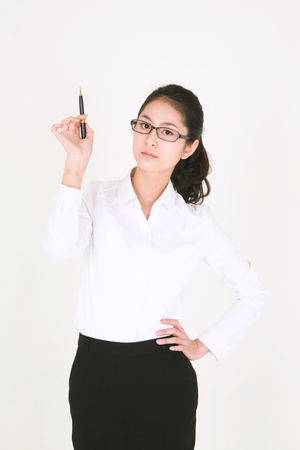 Young Asian businesswoman posing in the studio - isolated on white Stock Photo