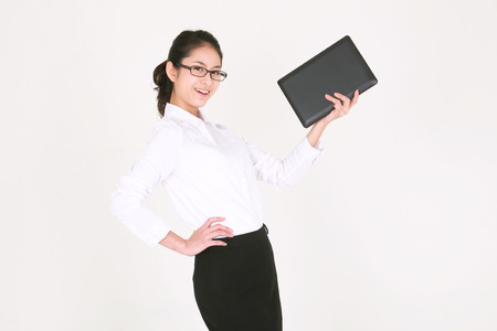blusa: Young Asian businesswoman posing in the studio - isolated on white Foto de archivo