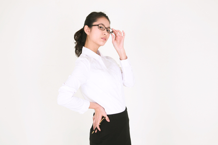 experiencing: Young Asian businesswoman posing in the studio - isolated on white Stock Photo
