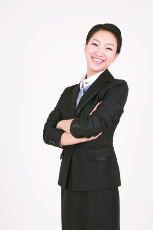 nobleness: Young Asian business woman posing in the studio - isolated on white
