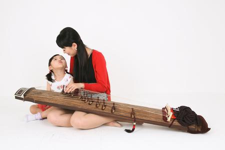 versatile: Music class - isolated on white Stock Photo