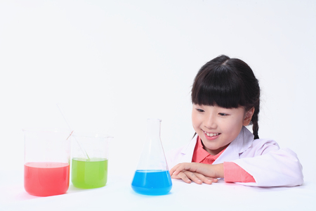 erlenmeyer: Children in a science class - isolated on white