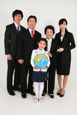 harmonious: Three generation family celebrating graduation - isolated on white