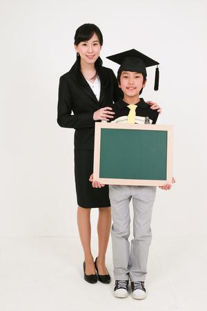 Three generation family celebrating graduation - isolated on white