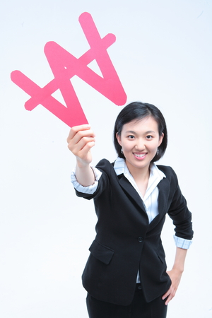Young Asian businesswoman posing with Korean Won symbol - isolated on white