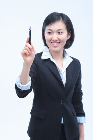 summarize: Young Asian businesswoman posing with a pen - isolated on white Stock Photo