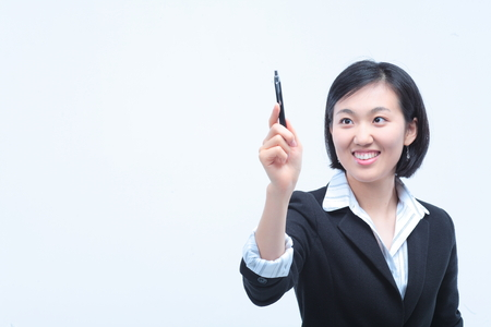 describing: Young Asian businesswoman posing with a pen - isolated on white Stock Photo