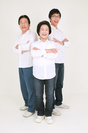 Three generation asian family dressed casually - isolated on white
