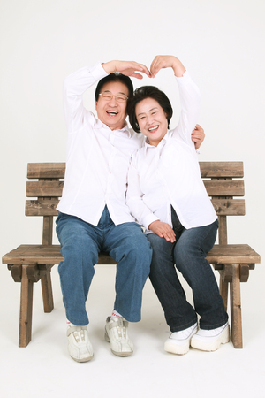 two persons only: Three generation asian family dressed casually - isolated on white