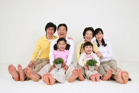 An asian big family dressed casually - isolated on white