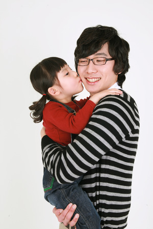harmonious: Asian young couple and a little girl - isolated on white Stock Photo