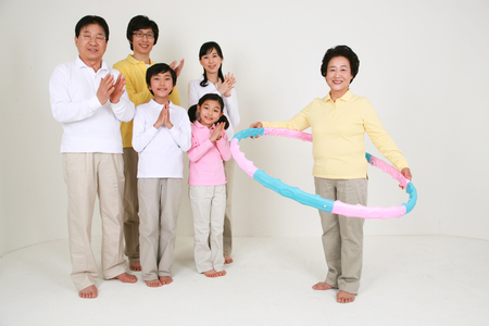 harmonious: An asian big family dressed casually - isolated on white