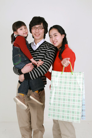 baby stuff: Asian young couple and a little girl - isolated on white Stock Photo