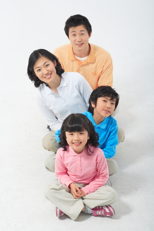 Asian couple with a little boy and girl - isolated on white Stock Photo