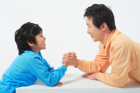 thrilled: Asian couple with a little boy and girl - isolated on white Stock Photo