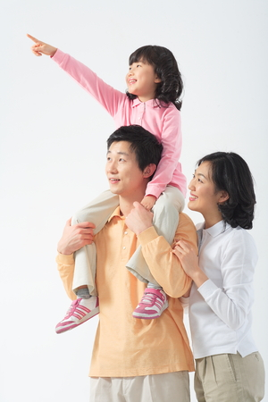 harmonious: Asian couple with a little boy and girl - isolated on white Stock Photo