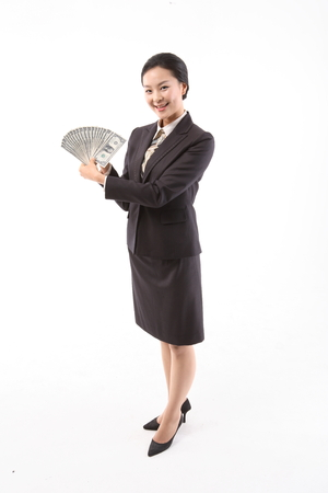 Asian businesswoman in uniform posing in the studio - isolated on white