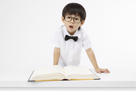 queries: Asian kids with education concept- Isolated on studio shot Stock Photo