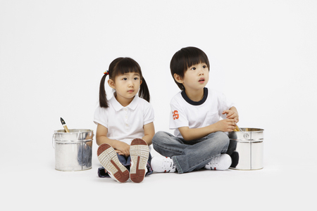Asian kids with education concept- Isolated on studio shot Banco de Imagens