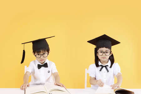 Asian kids with education concept- Isolated on studio shot 版權商用圖片