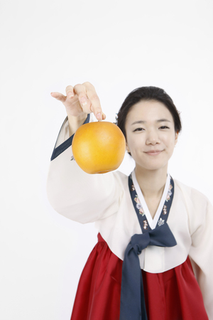 asian pear: korea traditional clothing, hanbok- Isolated on studio shot
