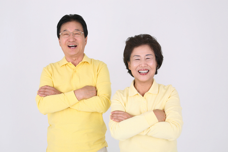 Old asian couples happy daily life - isolated on white