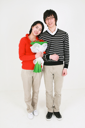 arm bouquet: Young asian couple in a studio - isolated on white