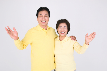 Old asian couple's happy daily life - isolated on white