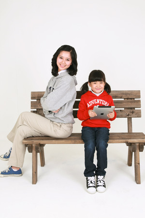 Asian mom and child - isolated on white