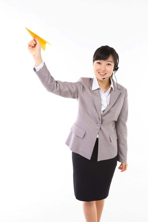 earbud: Asian businesswoman with a paper airplane - isolated on white Stock Photo