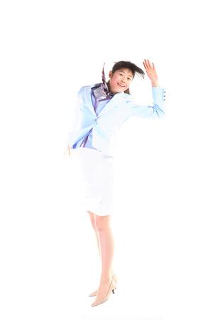 Aziatische vliegenier poseren in de studio - geïsoleerd op wit Stockfoto