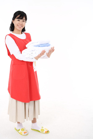 homemaker: Daily life of asian housewife - isolated on white Stock Photo