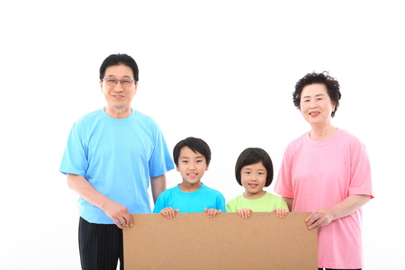 granddad: Asian grand parents and two kids - isolated on white Stock Photo