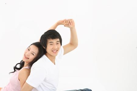 tender tenderness: Asian couple studio - isolated on white