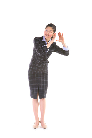 Asian businesswoman posing in the studio - isolated on white