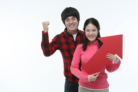 Asian college student couple studying in studio - isolated on white Stock Photo
