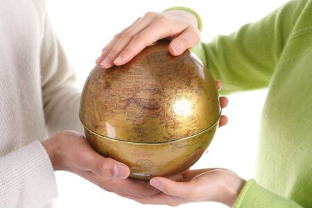 Hands holding up a globe - isolated on white