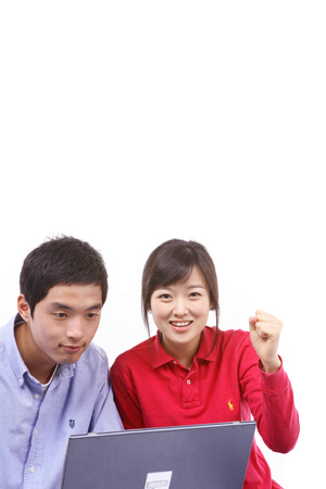 manhood: Young asian couple in studio - isolated on white