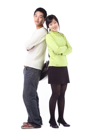 Young asian couple in studio - isolated on white